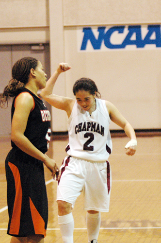 Lauren Kamiyama reacts after hitting a pivotal three-point shot over Occidental's Dior Williams, late in overtime at Chapman's Hutton Arena.