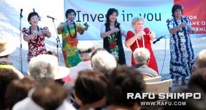 Harriet Nagada and dancers from Ka Nui Manu Wala Iau Hula perform on stage.