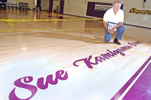 Ed Kamiyama looks over the floor at Bell High School's newly renamed Susan Kamiyama gymnasium.