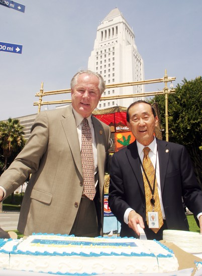 City Councilmember Tom LaBonge and Norman Arikawa, Los Angeles-Nagoya Sister City Association, cut a cake on Wednesday in celebration of the 50th anniversary of Sister City relations between Los Angeles and Nagoya. The Sister City relationship began on April 1, 1959.