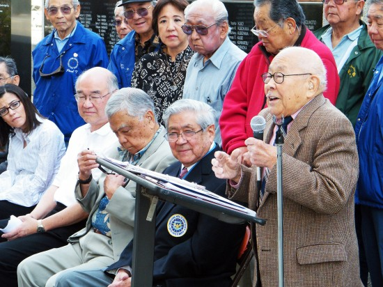 """Fred Hoshiyama, chair of a fundraiser for the maintenance of the National Japanese American Veterans Memorial Court, addresses a gathering on May 2 in Little Tokyo. Medal of Honor recipient Hiroshi """"Hershey"""" Miyamura, second from right, joined the Japanese American veterans and their supporters."""