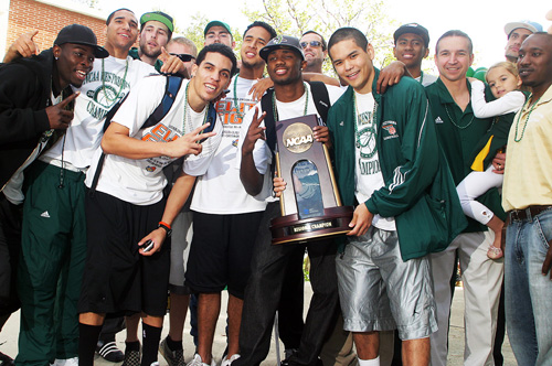 The Cal Poly Pomona Men's Basketball team holds up their Regional Championship trophy celebrating their incredible run to the NCAA Div. II Championships during a Pep Rally at the Cal Poly campus Thursday.