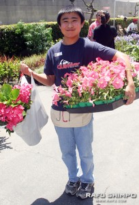 Nick Awakuni helps donate plants from the nursery owned by his family.