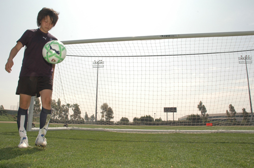 Aya Miyama takes time for a bit of dribbling, after Thursday's workout of the new Los Angeles Sol at the Home Depot Center in Carson.