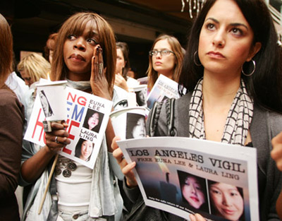 Supporters of jailed journalists Lee and Ling listen to speakers during a vigil in Santa Monica.