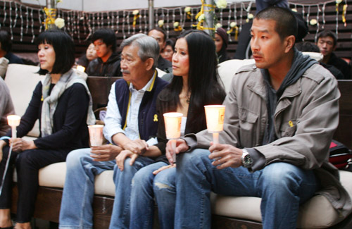 The family of Laura Ling, including her parents and sister Lisa, second from right, participate in the vigil.