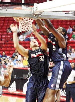 Newest Clipper, Blake Griffin watches as teammate DeAndre Jordan slams home a rebound.