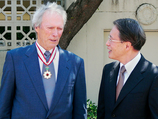 Clint Eastwood chats with Japanese Consul General Junichi Ihara Wednesday, July 22 at the consul general's residence, after the actor-director was bestowed with the Order of the Rising Sun, Gold Rays with Neck Ribbon. (Photo by LEO YANG)
