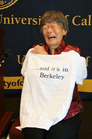 "Aiko ""Grace"" Obata Amemiya, a pre-nursing student at UC Berkeley in 1942, proudly holds up a CAL T-shirt that she purchased in 1938, after addressing the UC Board of Regents in San Francisco. (KAREN YOKOTA/Hokubei Mainichi)"