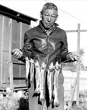 """A fisherman at Manzanar. Manzanar Committee received $49,400 for """"From Barbed Wire to Barbed Hooks."""" (Photo by Toyo Miyatake)"""