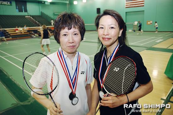 Fumiko Nakae, left, and Frances Fujinami show off their medals, won at last weekend's Senior International Badminton Championships at the Orange County Badminton Club.  (Photos by MICHAEL HIRANO CULROSS/Rafu Shimpo)