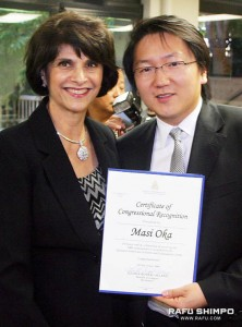 Oka receives the certificate of Congressional Recognition from Rep. Lucille Roybal-Allard.