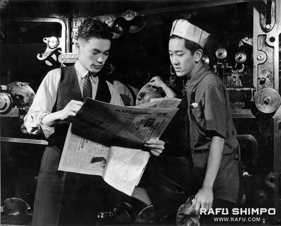 English Editor Togo Tanaka, left, inspects a copy of the Rafu Shimpo with pressman Yasuhei Nakanishi in this photo taken before World War II.