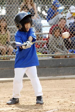 Katrina Yamasaki, Pee Wee Lower, SEYO All-Stars keeps her eye on the ball.