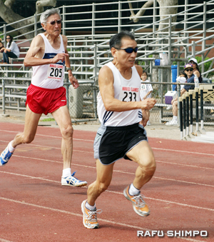 Francis Kishi and Joe Ogata take part in the over-60 100 meters.