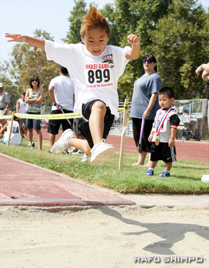 Kendell Oda takes flight in the long jump.