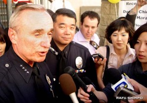 Bratton, flanked by Terry Hara, fields questions in Chinatown in February 2008. During Bratton's tenure, Hara was promoted to deputy chief, the first Asian Pacific American to hold the rank.
