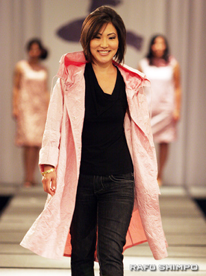 Steffanie Keiko Tamehiro, former 2005 Nisei Week Queen, takes her turn on the cat walk modeling one of the many designs.
