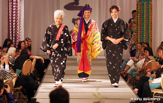 "Mother and daughter AsakoTomita, Tamlyn Tomita, and former Nisei Week Princess Saki Uechi model traditional Okinawan kimonos during the ""Kimono Through the Seasons of Life"" portion of the show, which was coordinated by Hiro Shichiro Bando. (Photos by MARIO G. REYES/Rafu Shimpo)"