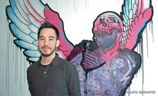 """Mike Shinoda stands before one of the final pieces in his """"Glorious Excess (Dies) at JANM. The exhibit runs through Oct. 4. (Photos by MICHAEL HIRANO CULROSS/Rafu Shimpo)"""