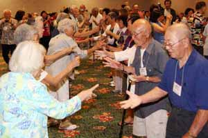 A jan-ken-po game was held with 175 players during the Heart Mountain Reunion. Each participant pitched in one dollar. The finals came down to Kimi Kishi and Kaz Marumoto.