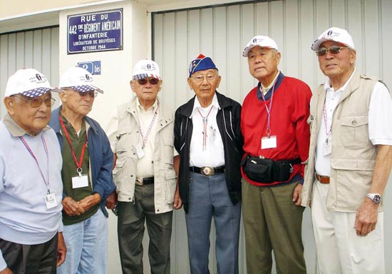 "Veterans of the 442nd Regimental Combat Team pose at the Rue de 442 in Bruyeres, France. From left, Art Iwasaki, George Kanatani, Sam Sakamoto, Nelson Akagi, Fumio ""Steve"" Shimizu, and Lawson Sakai. Nisei from the 442nd will reunite with soldiers from the Texas 141st Infantry Regiment in Houston on Nov. 1. (Courtesy of Ellen Sawamura, PhD)"