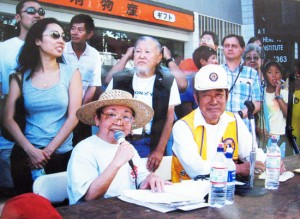 Kats Kunitsugu. left, emcees the Nisei Week Grand Parade with Joe Fukuhara in 2001. (Photos courtesy of JACCC)