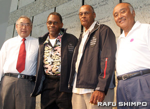 Edward Takahashi, left, and Ed Kamiyama, right, pose with long time referees and Aki Komai Memorial Award honorees Freeman Beale and Richard Banton.