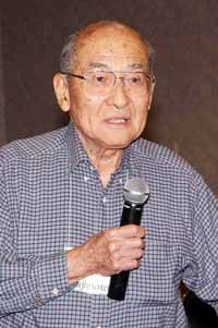 Sam Fujimoto tells of sneaking out of camp to go to a nearby river but getting caught by guards with rifles.