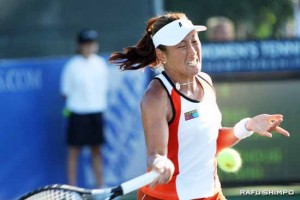 Ai Sugiyama returns serve in a doubles match in Carson at the LA Women's Open in July. After 17 years on the WTA, Sugiyama played her last match Monday, Sept. 28 in Tokyo forced to pull out due to illness. (Photos by JORDAN IKEDA/Rafu Shimpo)