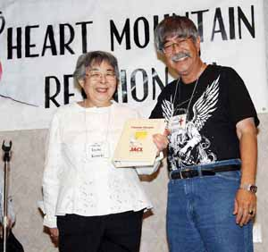 Youngest born in camp Doug Ichishita wins a cookbook from Irene Koseki of the Las Vegas Japanese American Citizens League.
