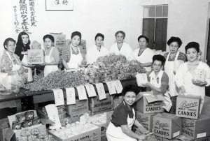 Members of the Japanese Women's Society of Southern California help pack 10,000 pounds of candy for war orphans in Japan in 1947.