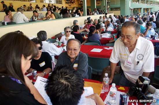 Attendees enjoy a view of the horse racing as well as lunch at the club house.