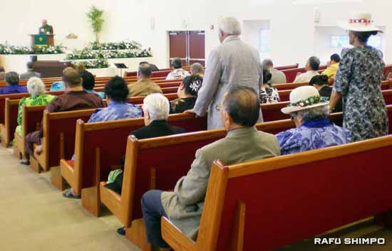 Congregants at the Samoan Congregational Christian Church of South Los Angeles pray for victims of the earthquake on Wednesday in Carson. The church is accepting donations for the disaster relief efforts. (Photos by GWEN MURANAKA)