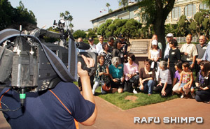 A cameraman from ESPN shoots footage of the Santa Anita reunion.