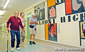 Terry Takasugi, left, Steve Ogawa and Roy Imazu stroll the hallways of Belmont High, which has changed drastically over the decades.