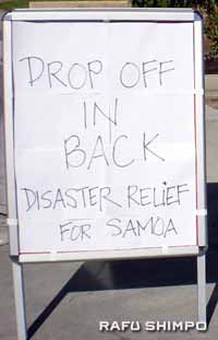 A sign in front of the church directs quake relief.
