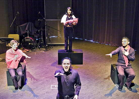 "Randy Guiaya, front, is joined by, from left, Helen Ota, Myra Cris Ocenar and Michael C. Palma, in ""Songs For A New World."" The production runs through Sunday at the National Center for the Preservation of Democracy in Little Tokyo. (Yes, and … Productions)"