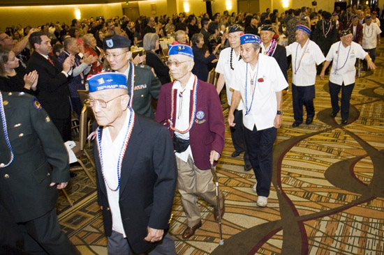 From left, Toke Yoshihashi (100th), Ken Miya (100th), Bones Fujimoto (442nd), Victor Abe (MIS), Ken Akune (MIS), Don Seki (442nd) and Hitoshi Sameshima (MIS) walk in a procession honoring veterans at the Go For Broke National Education Center's annual Evening of Aloha gala held last Saturday. (SHANE SATO/Little Tokyo)