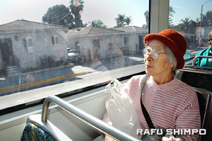 Monterey Park resident Yoshiko rides the new Gold Line Eastside Extension, after a shopping trip to Little Tokyo Monday.