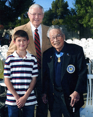 Supervisor Antonovich poses with his son, Michael, Jr. and Sakato as the Nisei vet was honored.