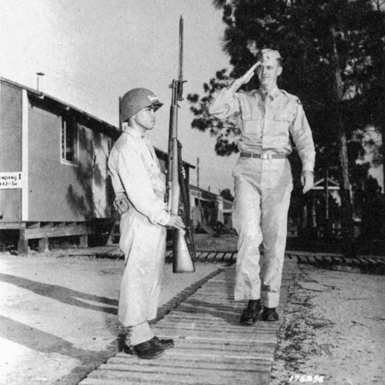 PFC Takeshi Kazumura (possibly the shortest soldier to serve in the U.S. Army) and Lt. Joseph Lawrence Byrne. (Courtesy of U.S. Army Signal Corp)