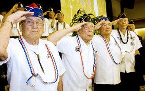 From left, Hiro Nishikubo, Sameshima, Seki, Abe and Akune salute as a color guard of soldiers from today's 100th Battalion, 442nd Infantry of the U.S. Army Reserves, Hawaii posts the American flag.