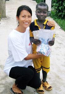 Smiling with a 6-year-old boy from Sierra Leone who was successfully treated for tuberculosis.