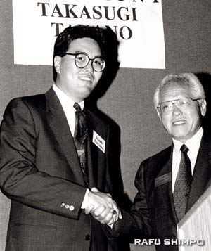 Mark Takano and Takasugi at a political fundraiser in the '90s. (MARIO G. REYES/Rafu Shimpo)