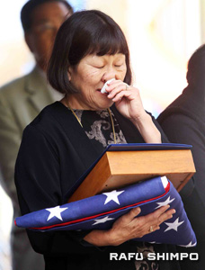 Mary Nakata Sunada receives the medals of her late father Yoneto James Nakata at a Veteran's Day event held Nov. 7 in Artesia.