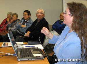 Alisa Lynch, left, of Manzanar National Historic Site, makes a presentation last Thursay.