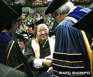 Takahashi receives his degree from UC Davis Chancellor Linda P.B. Katehi, left, and Dean Neal Van Alfen.