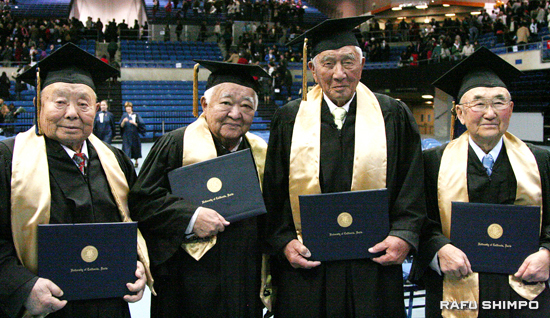 From left, Ben Mitsuo Hatanaka, Harold Haruya Takahashi, Yoshio John Kashiki and Frank Inami pose with their honorary degrees after the fall commencement held at UC Davis ARC Pavilion last Saturday. The university issued 47 degrees for those who were forced to leave the school due to the evacuation and incarceration of Japanese Americans in 1942. (Photos by JORDAN IKEDA/Rafu Shimpo)