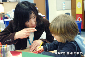 The Japanese classes in the FLAG program will be structured similarly to the current Korean immersion classes. Above, Darae Kim assists a young student, one of several who had no exposure to Korean.